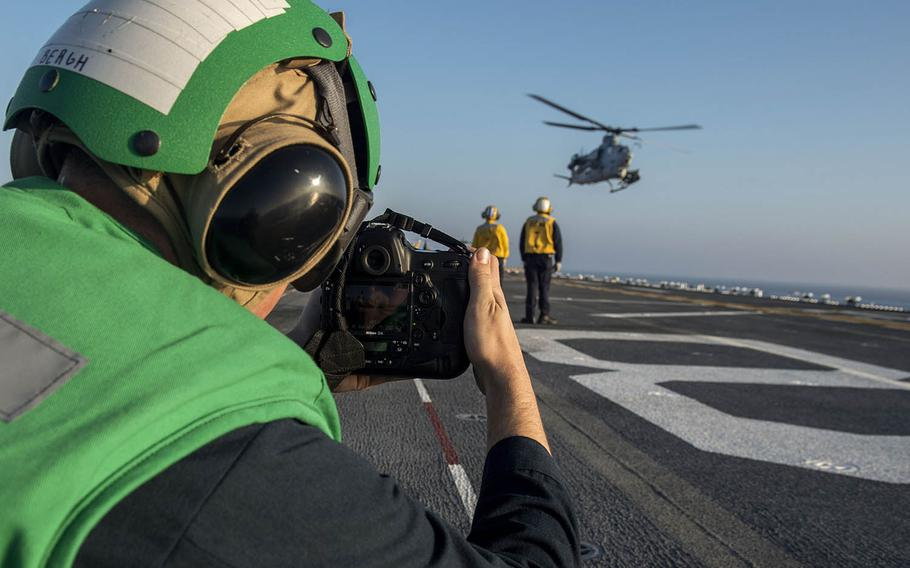 Petty Officer 3rd Class Jacob Bergh, a mass communication specialist, captures video of an AH-1Z Viper helicopter taking off from the USS Makin Island in November.