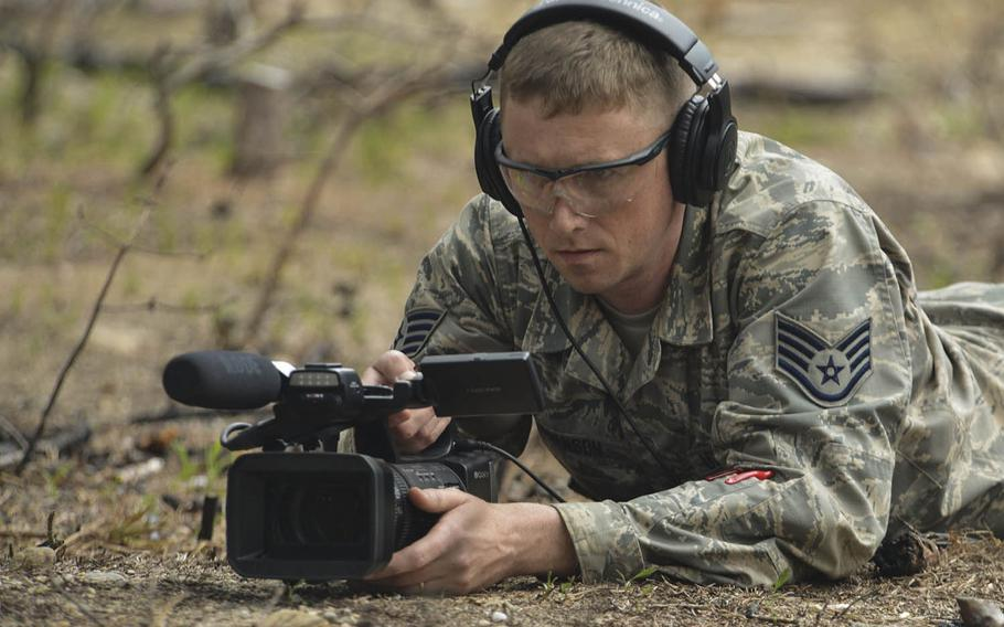 Air Force Staff Sgt. Thomas Swanson films an exercise in Massachusetts in 2018.