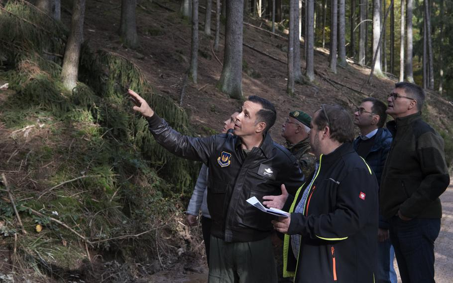 U.S. Air Force Col. Jason Hokaj, 52nd Fighter Wing vice commander, and German community leaders visit the site near the German city of Trier where an F-16 fighter jet crashed on Oct. 8, 2019. A partial power failure combined with bad weather caused the jet to crash,the Air Force said Tuesday.
