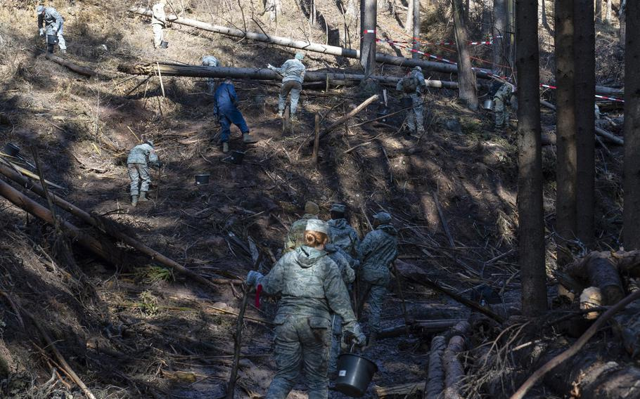 U.S. airmen from the 52nd Fighter Wing  search and recover wreckage from an F-16 Fighting Falcon that crashed near Zemmer, Germany, Oct. 8, 2019. A partial power failure combined with bad weather caused the jet to crash, the Air Force said Tuesday.