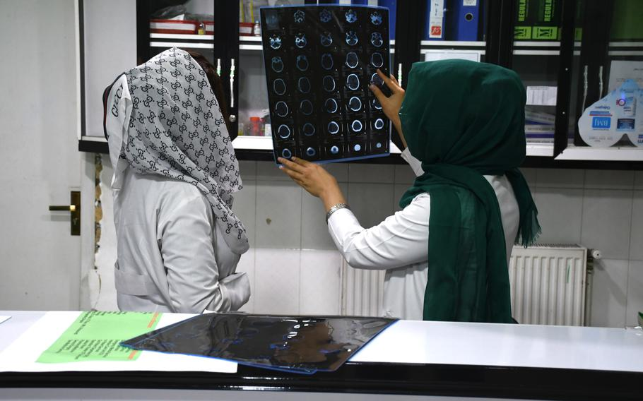 Female staff at Blossom Health Care Center in Kabul examine scans on Aug. 24, 2019. Blossom is one of numerous healthcare facilities that opened in Afghanistan following the U.S.-led invasion in 2001.