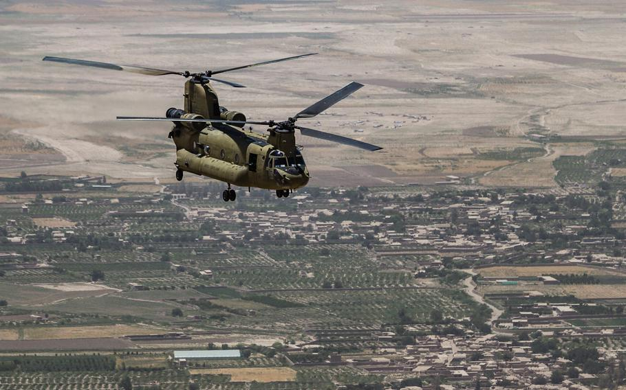 A U.S. Army Reserve CH-47 Chinook helicopter flies over Helmand Province, Afghanistan, in June 2017. The Pentagon plans to send 20 Chinook helicopters to Afghan special forces, according to a Pentagon brief.