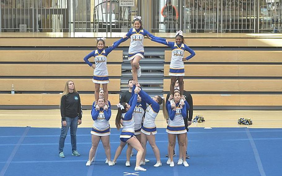 The Sigonella cheer squad completes a pyramid that was part of its routine during the DODEA-Europe Cheer Tournament held at the Clay Kaserne Fitness Center on Saturday, Feb. 22, 2020. Sigonella placed third overall in Division III.