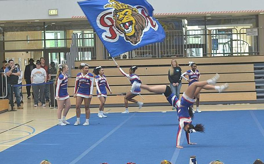 The Ramstein cheer squad used strong tumbling and a flag as part of its routine during the DODEA-Europe Cheer Tournament held at the Clay Kaserne Fitness Center on Saturday, Feb. 22, 2020. The squad won the Division I title.