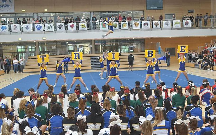 The Wiesbaden cheer squad used strong partner stunts and signs as part of its routine during the DODEA-Europe Cheer Tournament held at the Clay Kaserne Fitness Center on Saturday, Feb. 22, 2020. The Warriors placed second for the second year in a row.