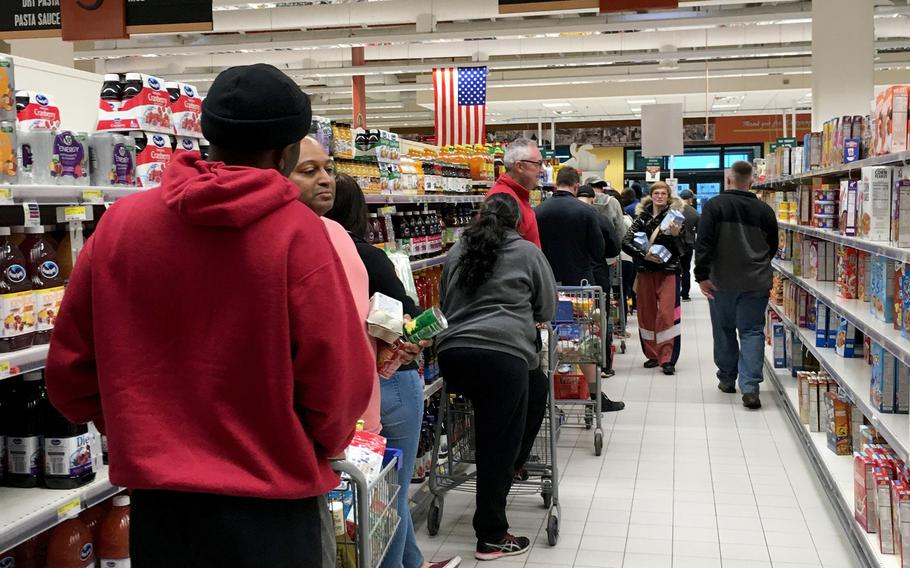 Vicenza commissary shoppers wait in long lines to check out after stocking up Sunday, Feb. 23, 2020,  amid uncertainty about the coronovirus' spread in Italy. The virus has already caused U.S. officials to close base schools, child care centers, gyms and theaters.