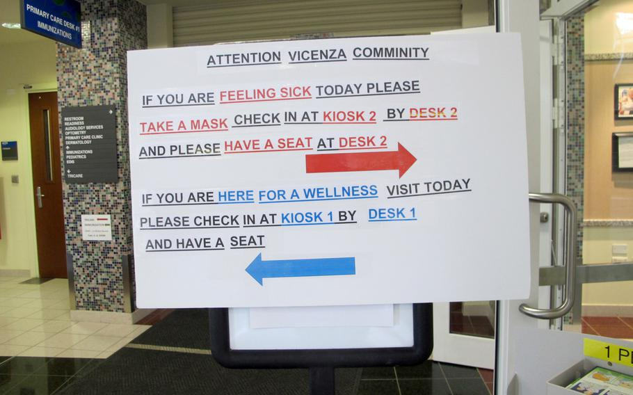 A sign at the U.S. military health care center in Vicenza, Italy, directs patients to take a surgical mask and go to the primary care desk if they feel unwell. U.S. Army Garrison Vicenza has taken numerous steps to try to stem the spread of the coronavirus, which has infected hundreds in Italy.