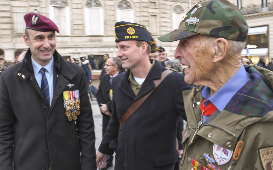 Shortly before a twilight ceremony at the Arc de Triomphe in Paris on Friday, Feb. 14, 2020, are, from left, French Afghanistan veteran Cyril Pefaure, U.S. Navy veteran and American Legion post commander Brian Schell, and World War II Army veteran Stephen Weiss. Weiss worked with the Office of Strategic Services, a precursor of the CIA, behind enemy lines in 1944. Weiss, 94, died last week in his London apartment.