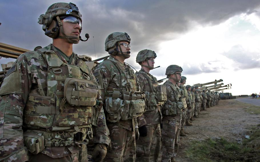 U.S. Army soldiers from the 3rd Infantry Division line up to meet U.S. and Polish dignitaries during a event at Drawsko Pomorskie Training Area, Poland, in support of Defender-Europe 20, March 11, 2020. The Pentagon ordered a halt to the deployment of forces for the exercise, which will be sharply curtailed because of concerns about the coronavirus, U.S. European Command said Monday.
