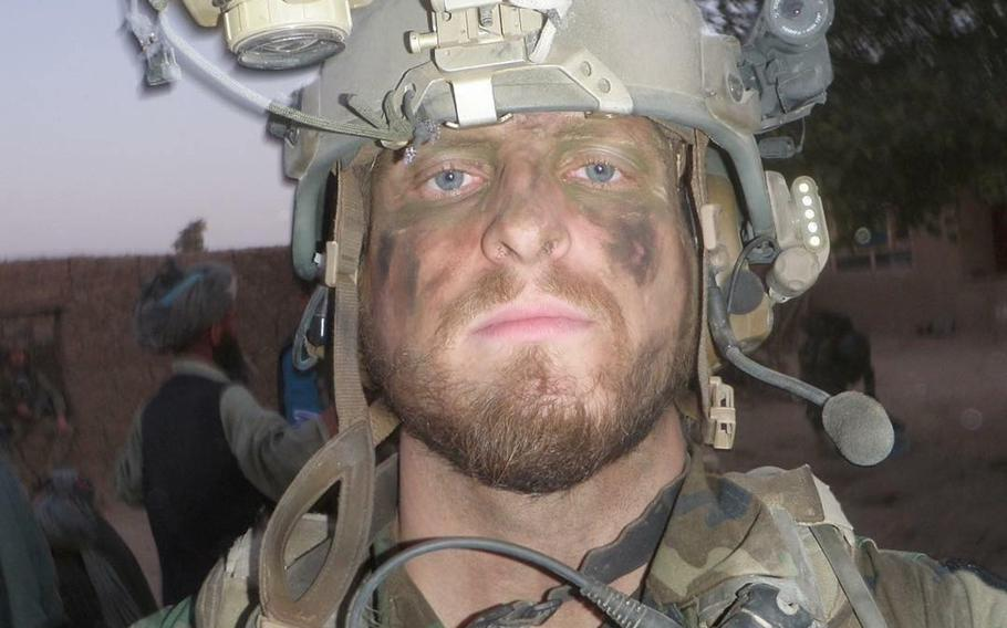 Kevin Flike, a Green Beret at the time, takes a selfie while on a patrol in in northern Afghanistan in 2011. Flike, 35, promised himself he would run a marathon after getting shot by a Taliban sniper in Afghanistan on that deployment.