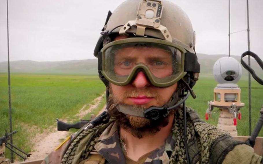Green Beret Kevin Flike takes a selfie while on patrol in an Army Ground Mobility Vehicle in Baghlan province, Afghanistan, in 2010.