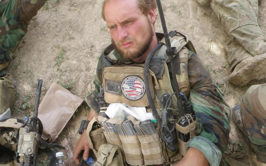 Green Beret Kevin Flike rests prior to a large Taliban attack on his unit in Faryab province in northern Afghanistan on May 13, 2011. Flike, 35, said he got perhaps one hour of sleep in the two-day gunfight that occurred after this photo was taken.