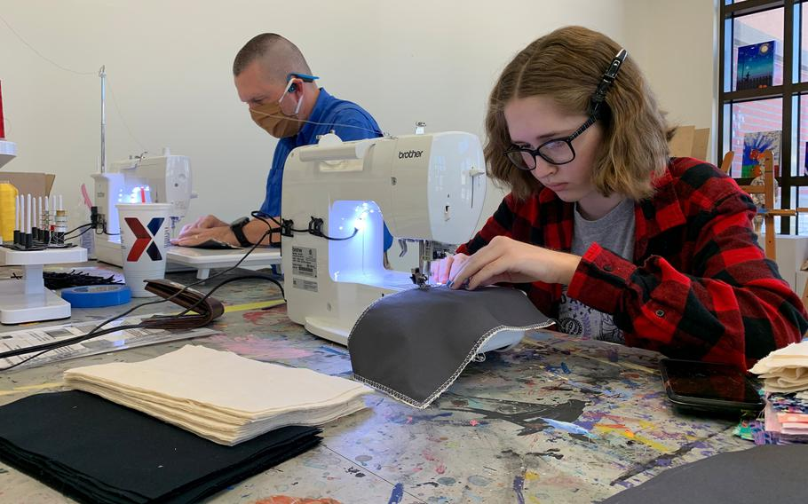Craig Frank, 48, of Vermillion, S.D., teamed up with his daughter, Anastasia Frank, 16, to sew cloth masks as part of a volunteer initiative for the military community at Camp Humphreys, South Korea, Wednesday, April 8, 2020.
