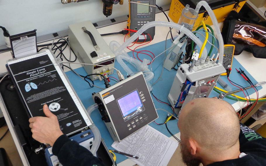 A biomedical equipment specialist conducts depot-level maintenance on a ventilator at Tobyhanna Army Depot, Pa., March 23, 2020.