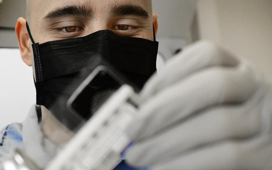 Tech. Sgt. Jordan Rigor, 48th Medical Support Squadron, conducts coronavirus testing at RAF Feltwell, England, April 9, 2020. Having the capability to test locally has reduced the wait time for results from 5 to 7 days to less than 24 hours.