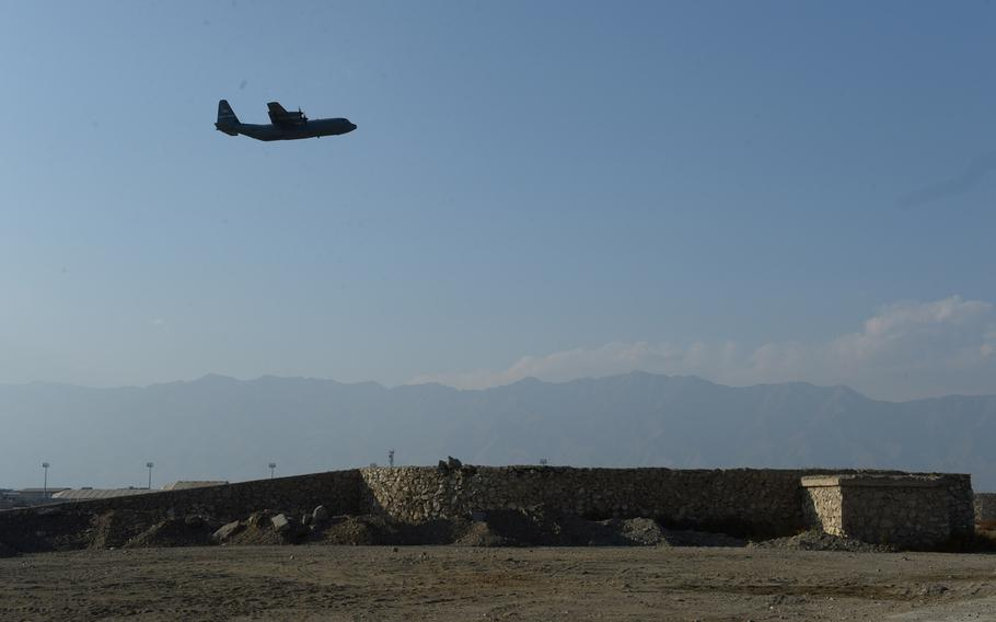 A U.S. aircraft takes off at Bagram Airfield in 2016. Six Afghan workers at Bagram were killed about 500 yards from the base by a gunman Thursday, an Afghan official said.
