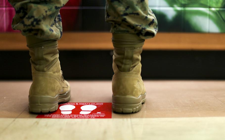A floor decal reminds customers to practice social distancing at an exchange store at Camp Foster, Okinawa, March 31, 2020.
