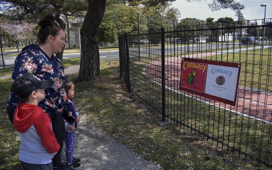 Danielle Carmona and her children, Camden, 6, and Kaia, 4, follow a story walk early this month at Sagamihara Housing Area near Camp Zama, Japan.