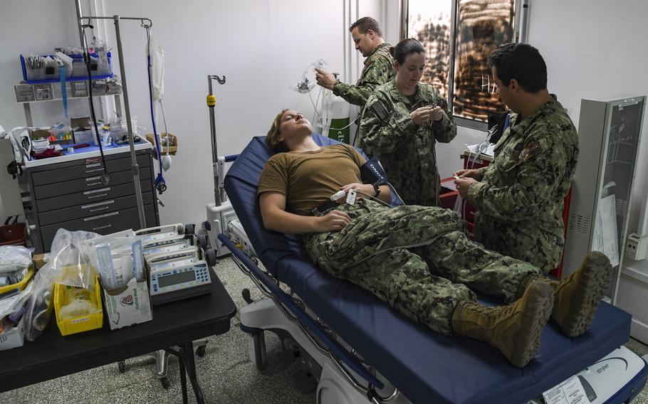 Staff from the Expeditionary Medical Facility demonstrate medical equipment used to stabilize patients at the COVID-19 Intensive Care Unit facility at Camp Lemonnier, Djibouti, April 9, 2020. The COVID-19 ICU is separate from the medical facility to prevent potential cross-contamination of the virus.