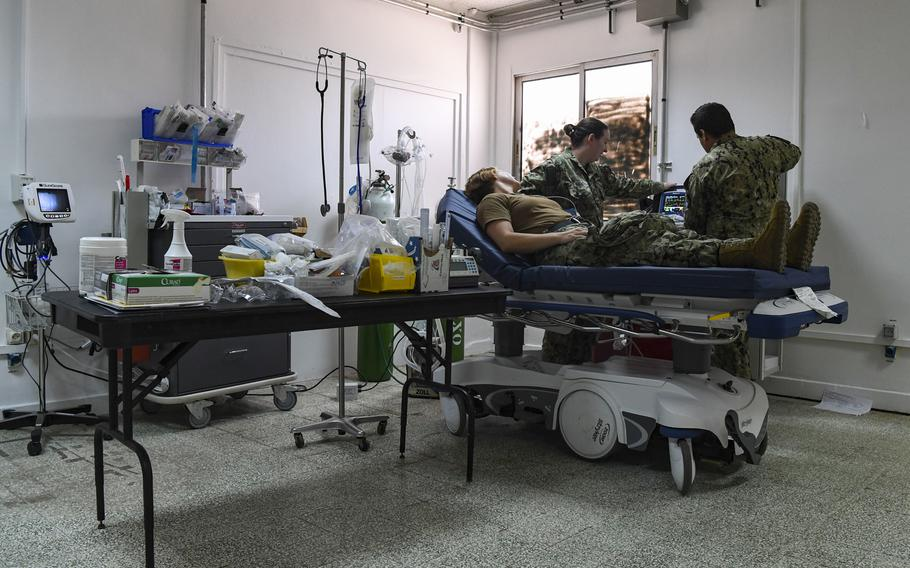 Staff from the COVID-19 Intensive Care Unit demonstrate its medical and equipment capabilities at Camp Lemonnier, Djibouti, April 9, 2020.
