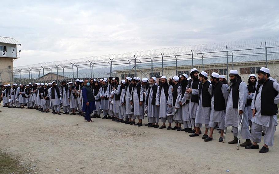 Taliban prisoners line up before being released by Afghan authorities in April 2020. The Taliban rejected calls from senior U.S. and Afghan officials for a cease-fire during the Muslim holy month of Ramadan, which started Thursday, April 23, 2020, until thousands more of its fighters have been released from government jails.