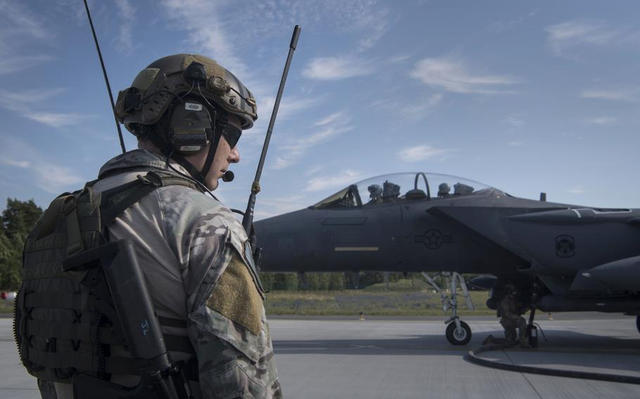 A U.S. Air Force Special Tactics Operator monitors communications while logistics readiness airmen fuel an F-15E Strike Eagle during an exercise at Amari Air Base, Estonia, in July 2019. The U.S. was the top military spender by a wide margin in 2019, accounting for 38% of global military expenditures, a report released Sunday, April 26, 2020 by the Stockholm International Peace Research Institute shows.