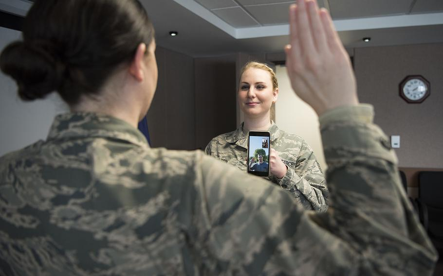 Staff Sgt. Elysia Wilson, 168th Wing production recruiter, helps enlist a new recruit using a video conference call April 16, 2020, at Eielson Air Force Base, Alaska. This virtual enlistment allowed a new Alaska Air National Guard recruit to complete their oath of enlistment while complying with COVID-19 safety regulations.