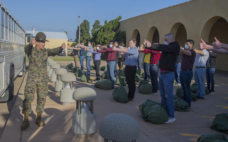 New recruits with Echo Company, 2nd Recruit Training Battalion, respond to orders during receiving at Marine Corps Recruit Depot, San Diego, May 4, 2020. At this point, recruits are informed of the articles under the Uniform Code of Military Justice.