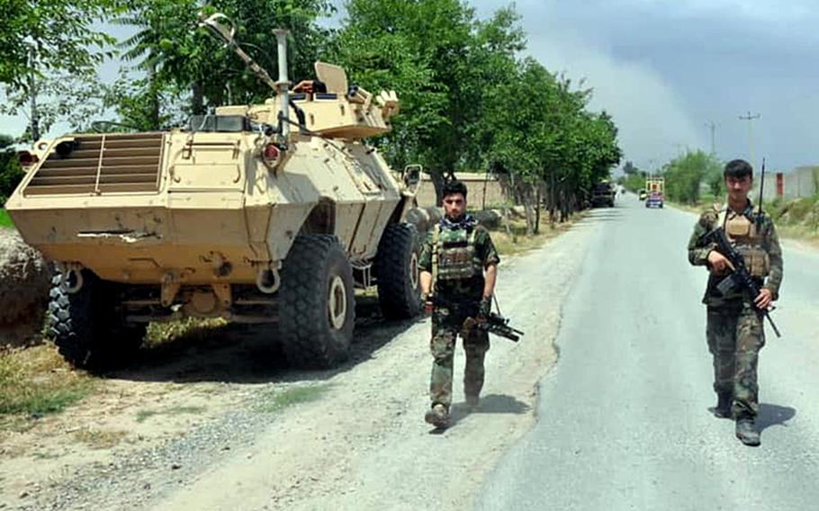 Afghan soldiers patrol a road in northern Kunduz province on Tuesday, May 19, 2020, after the country?s defense ministry said local forces were successful at repelling Taliban advances throughout the night.