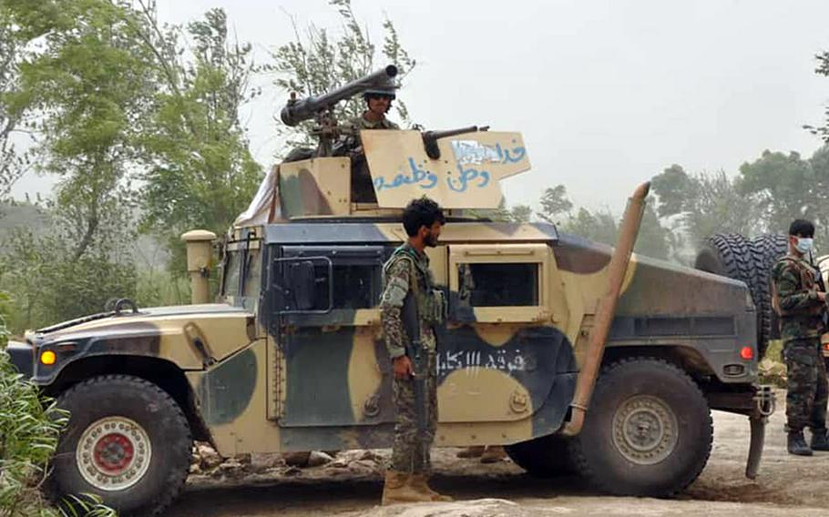 An Afghan soldier stands by a Humvee in northern Kunduz province on Tuesday, May 19, 2020, after the country?s defense ministry said local forces were successful at repelling Taliban advances throughout the night.
