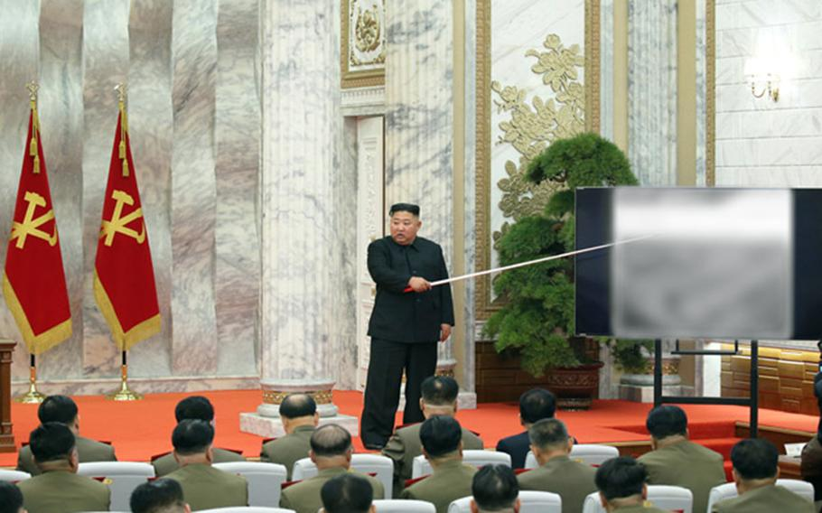 North Korean leader Kim Jong Un presides over a meeting of the central military commission of the ruling Workers' Party in this undated photo published by the Korean Central News Agency on Sunday, May 24, 2020.