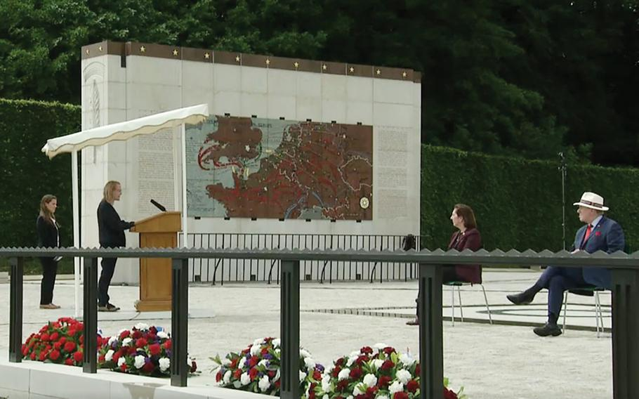 A screenshot shows Cecile Jimenez speaking during a Facebook Live stream of the U.S. Embassy in Luxembourg's Memorial Day service at the Luxembourg American Cemetery on Saturday, May 23, 2020. Jimenez, a nurse practitioner, is a medical officer at the embassy and spoke about the sacrifice health care workers make on the front lines of both war and the fight against viruses like COVID-19, the pandemic that forced officials to stream the ceremony online rather than have a large gathering.