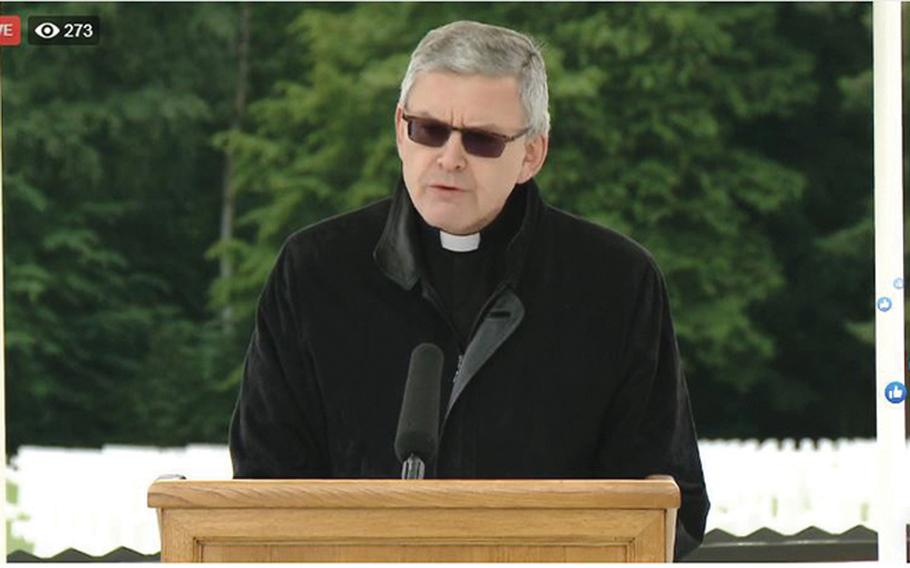 A screenshot shows Father Jean Ehret, a professor of religious studies at Luxembourg's Sacred Heart University, giving the invocation during a Facebook Live stream of the U.S. Embassy in Luxembourg's Memorial Day service at the Luxembourg American Cemetery on Saturday, May 23, 2020.