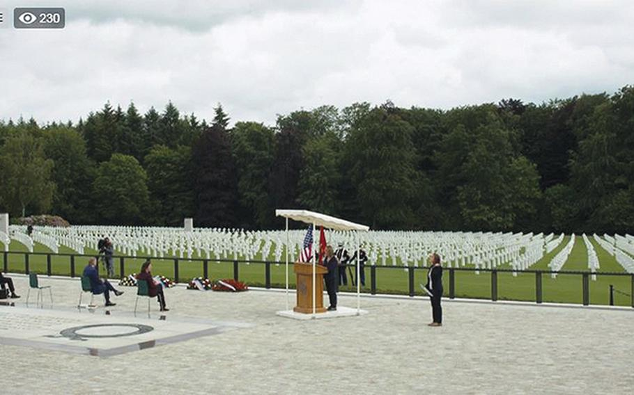 A screenshot of a Facebook Live stream of the U.S. Embassy in Luxembourg's Memorial Day service at the Luxembourg American Cemetery on Saturday, May 23, 2020, shows the few participants at the event seated far apart due to concerns about the coronavirus. Members of the Marine Corps color guard in the background all wore masks.