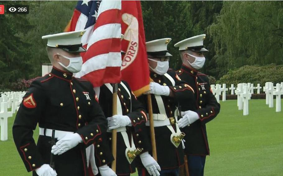 Members of a Marine Corps color guard from the U.S. Embassy in Luxembourg wore masks during a Facebook Live stream of the embassy's Memorial Day service at the Luxembourg American Cemetery on Saturday, May 23, 2020, in a screenshot from the event streamed online.