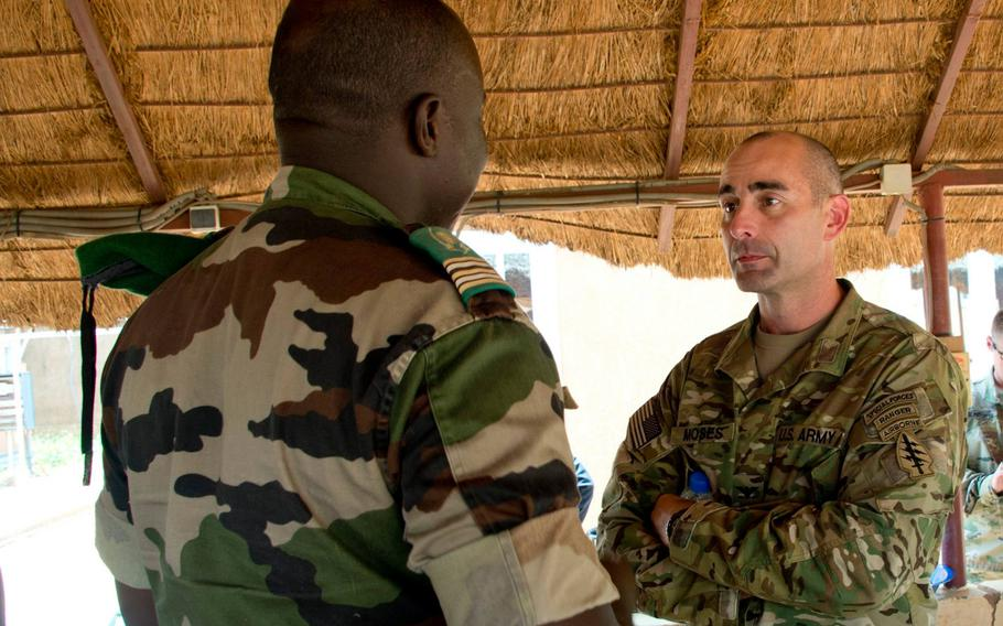 Col. Bradley D. Moses, commander of 3rd Special Forces Group, speaks with the commander of Nigerien special operations forces in Niger, Sept. 6, 2017. Moses' nomination for a promotion was withdrawn by the Army, unnamed defense officials said Friday, according to The New York Times.
