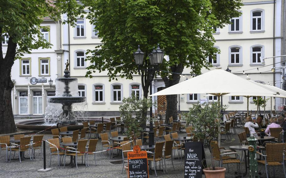 St. Martinplatz in downtown Kaiserslautern, Germany, is pictured here on Tuesday, June 9, 2020. An easing of coronavirus restrictions in the state of Rheinland-Pfalz, which includes the city, will allow patrons to visit restaurants without reservations. Establishments will also be allowed to remain open until midnight under the new rules, which take effect Wednesday, June 10.