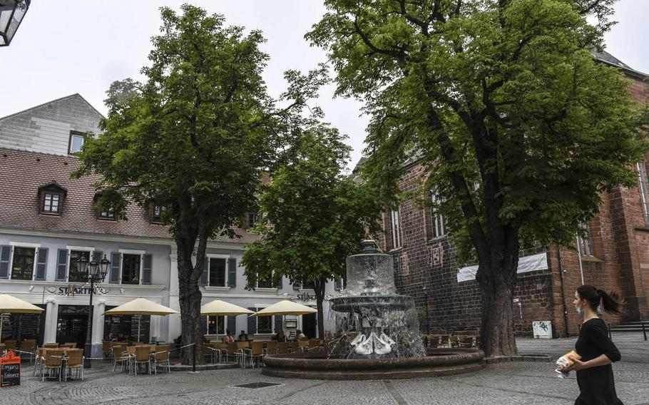 St. Martinplatz in downtown Kaiserslautern, Germany, is shown Tuesday, June 9, 2020. An easing of coronavirus restrictions in the state of Rheinland-Pfalz, which includes the city, will allow patrons to visit restaurants without reservations. Establishments will also be allowed to remain open until midnight under the new rules, which take effect on Wednesday, June 10.