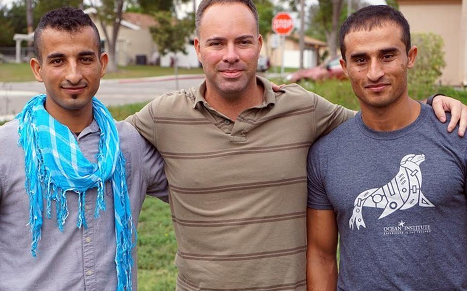 Mohammad Nadir, from left, Marine Corps Maj. Mark Nicholson and Fnu Farid reunite in 2017 in California after serving together in Sangin District, Helmand province, Afghanistan.