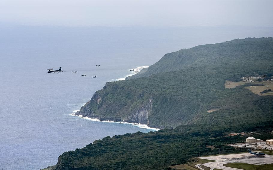 Aircraft fly in formation over Andersen Air Force Base, Guam, during the Cope North exercise, Feb. 19, 2020.