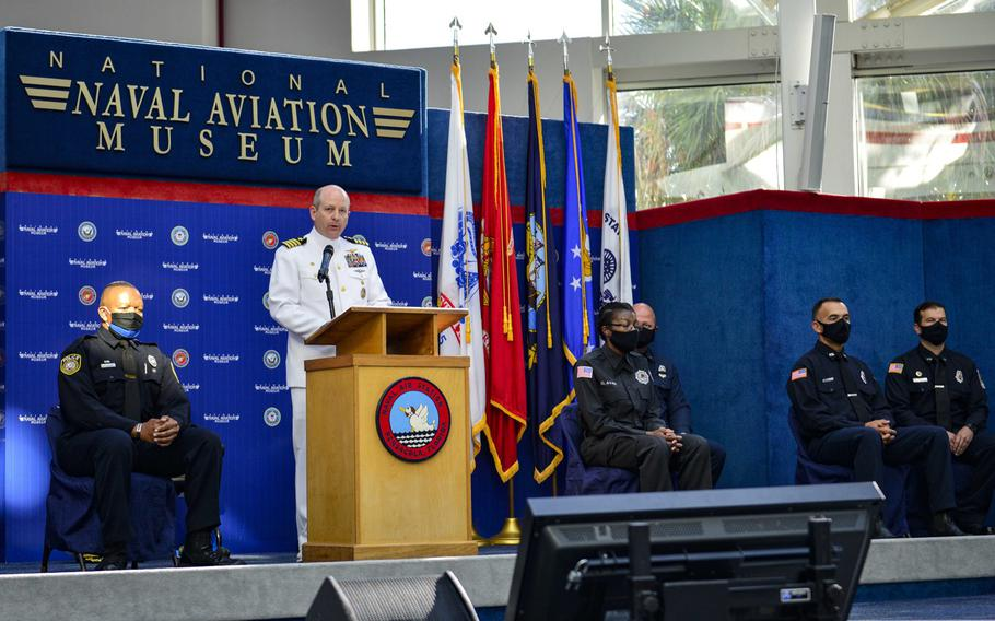 Capt. Tim Kinsella, commanding officer of Naval Air Station Pensacola, Fla., delivers remarks during an awards ceremony at the National Naval Aviation Museum at Naval Air Station Pensacola, June 16, 2020, to recognize personnel who responded to the Dec. 6, 2019 terrorist attack at the installation.