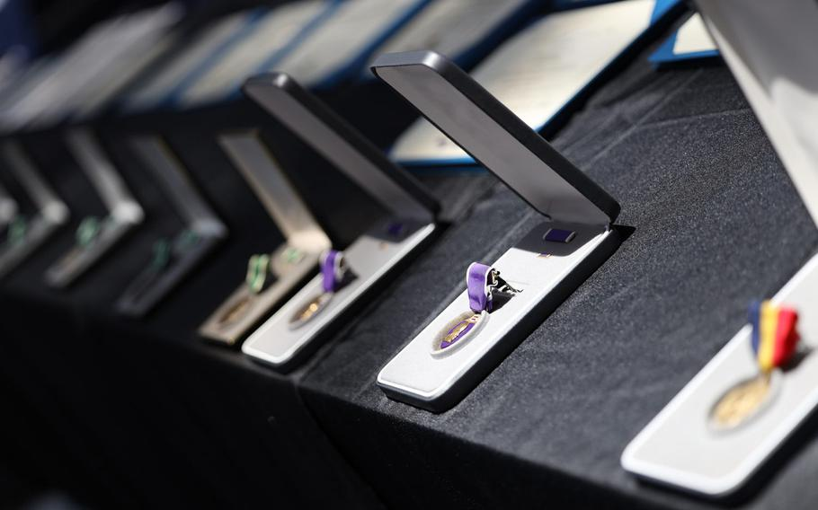 Medals are displayed prior to being awarded to 12 service members and federal employees, who were recognized for their bravery and selflessness during the Dec. 6 shooting at Naval Air Station Pensacola, Fla., June 19, 2020.