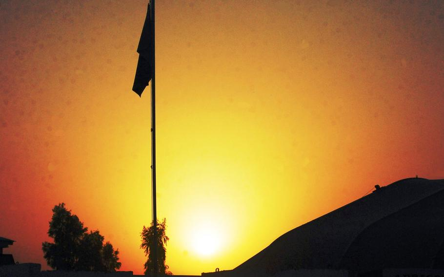 The sun sets over Forward Operating Base Fenty, Afghanistan, in this file photo. Military contractor Fluor Corp. was ordered to cease providing many services at the base near the city of Jalalabad, according to a memo issued June 22, 2020, as part of coronavirus prevention measures.