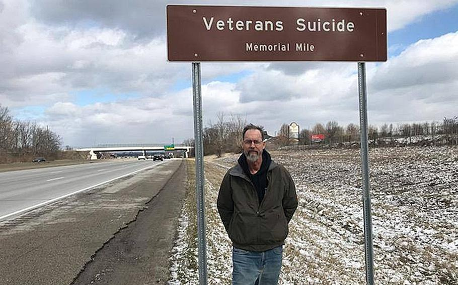 Howard Berry at mile marker 22 on I-71 in Ohio, designated as Veterans Suicide Memorial Mile. Berry, who spent seven years working to get a Purple Heart for his son and sought to raise awareness about veteran suicide, died last month after a battle with cancer.