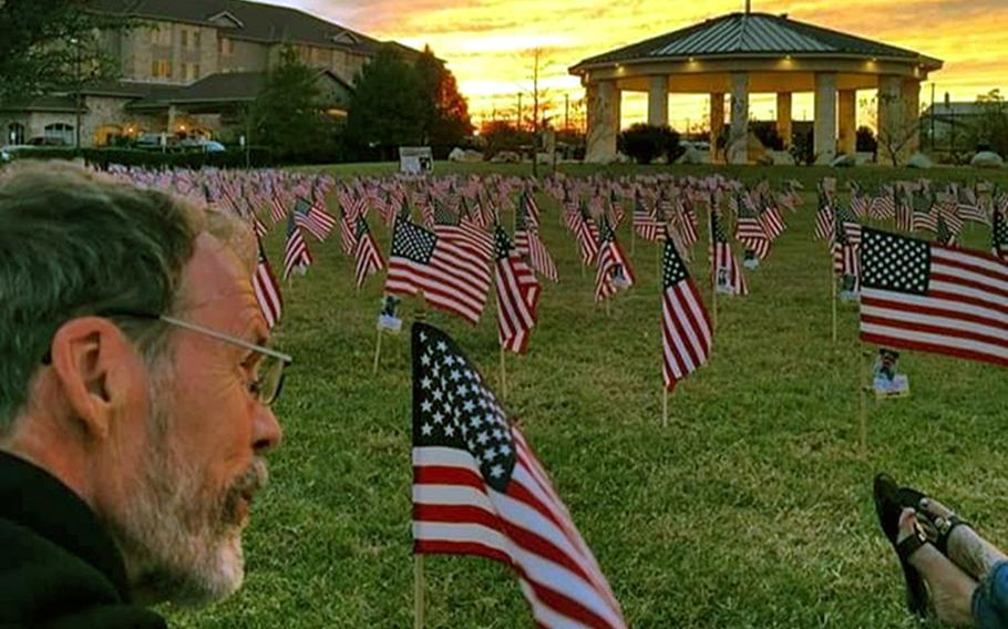 Howard Berry sits among rows of American flags. The ''Flags for Forgotten Soldiers'' initiative was a brainchild of  Berry, a Cincinnati, Ohio, man who lost his son, Army Staff Sgt. Joshua Berry, to suicide. Berry died last month after a battle with cancer.