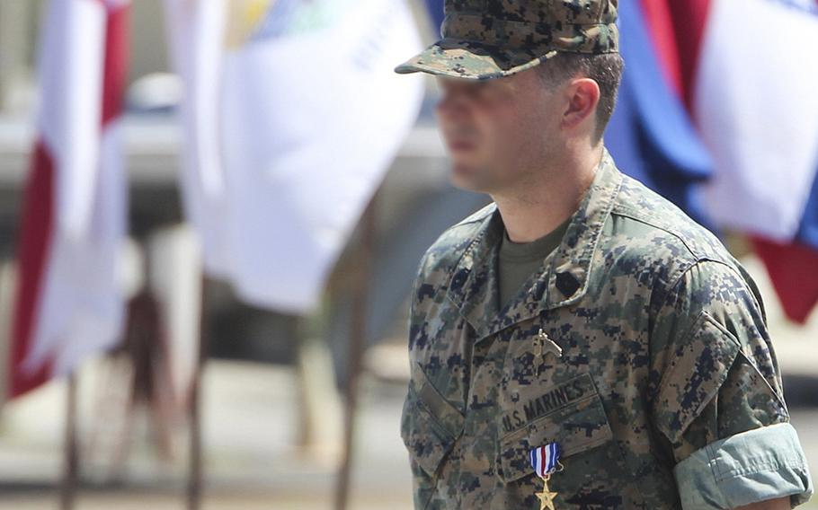 A Marine Raider, whose face was blurred in this photo by the service, was awarded the Silver Star Medal for heroic actions while deployed to Afghanistan in 2019, at a ceremony at Camp Lejeune, N.C.. July 10, 2020.
