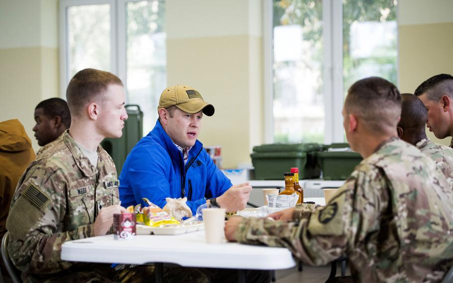 Then-Acting Army Secretary Ryan McCarthy has lunch at a dining facility with soldiers from multiple units  deployed to Powidz Air Base, Poland, in September 2017.  McCarthy said during a July 15, 2020, call with reporters that details of a Pentagon plan to pull nearly 10,000 troops out of Germany will be disclosed in the coming weeks.