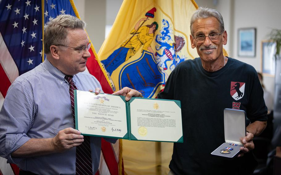 Rep. Chris Smith, left, presents Vietnam War veteran Bart ''Doc'' Fabian with his second Silver Star at a ceremony in Smith's office in Freehold, N.J., July 18, 2020. Fabian earned the medal for saving the lives of 10 fellow soldiers in a battle on April 13, 1969.