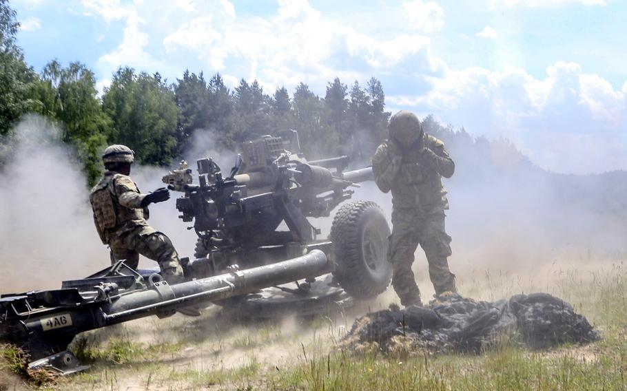 Paratroopers of 4th Battalion, 319th Airborne Field Artillery Regiment, 173rd Airborne Brigade, fire a M119A3 howitzer during a live-fire exercise at Grafenwoehr Training Area, Germany, June 3, 2020. Under the Pentagon's plan to reduce troops in Germany, the unit, now stationed at Grafenwoeh, would move to Vicenza, Italy.
