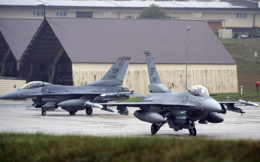 U.S. Air Force F-16 Fighting Falcons taxi toward a runway  at Spangdahlem Air Base, Germany. The squadron would move from Spangdahlem to Aviano Air Base, Italy, under a plan announced by Defense Secretary Mark Esper on Wednesday, July 29,  2020, to cut the number of troops in Germany by nearly 12,000.